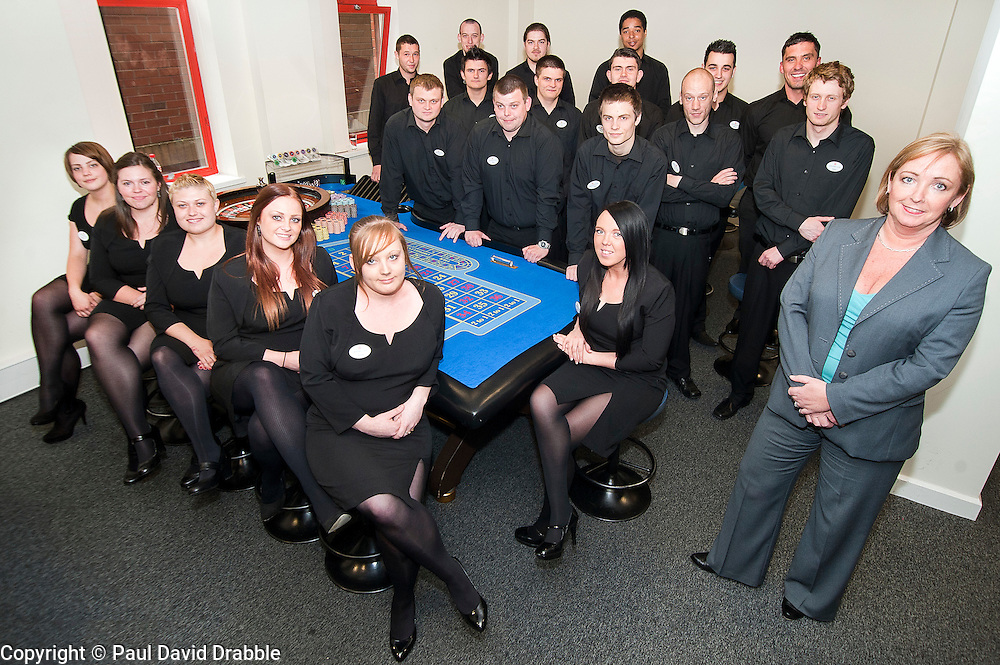 Jo Kinder (right) with the first twenty trainees to attend the Genting Club Croupier School in Sheffield..13 June 2012.Image © Paul David Drabble