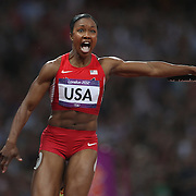 Carmelita Jeter, USA, shows her delight as she brings home the USA Women's 4 x 100 relay team of Tianna Madison, Allyson Felix, Bianca Knight and Carmelita Jeter in world record time to win the Gold Medal at the Olympic Stadium, Olympic Park, during the London 2012 Olympic games. London, UK. 10th August 2012. Photo Tim Clayton