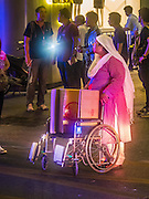 Aug. 17, 2015 - Bangkok, Thailand - <br /> <br /> Huge Explosion Rocks Bangkok Landmark<br /> <br /> A woman pushes a wheelchair at the scene of an explosion at Erawan Shrine. There are several large high end tourist hotels in the vicinity of the shrine and many hotel guests came out to watch the commotion. An explosion at Erawan Shrine, a popular tourist attraction and important religious shrine, in the heart of the Bangkok shopping district killed at least 19 people and injured more than 120 others, mostly foreign tourists, during the Monday evening rush hour. Twelve of the dead were killed at the scene. Thai police said an Improvised Explosive Device (IED) was detonated at 18.55. Police said the bomb was made of more than six pounds of TNT stuffed in a pipe and wrapped with white cloth. Its destructive radius was estimated at 100 meters. The Bangkok government announced that public schools would be closed Tuesday as a precaution.<br /> ©Exclusivepix Media