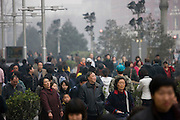 Crowded street corner of Chang An Avenue and Wangfujing Street in Beijing, China