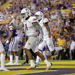 Sep 14, 2019; Baton Rouge, LA, USA; Northwestern State Demons wide receiver Quan Shorts (1) celebrates with wide receiver Akile Davis (9) after a touchdown against the LSU Tigers during the first quarter at Tiger Stadium. Mandatory Credit: Derick E. Hingle-USA TODAY Sports