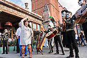 Rachel Navejar and Edward Phillips celebrate their wedding to a mariachi band dressed as skeletons for the Day of the Dead festival in the Jardin Principal October 28, 2016 in San Miguel de Allende, Guanajuato, Mexico. The week-long celebration is a time when Mexicans welcome the dead back to earth for a visit and celebrate life.