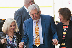 London, June 19th 2014. Entertainer and artist Rolf Harris, his daughter Bindi,  left, and niece Jenny arrive at Southwark Crown Court as the jury in his tial on twelve charges of indecent assault against four girls aged 7 to 19 is expected to begin its deliberations.