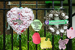 © Licensed to London News Pictures. 14/06/2019. London, UK. Messages and tributes are left on railings to commemorate the second anniversary of the Grenfell Tower fire service. On 14 June 2017, just before 1:00am a fire broke out in the kitchen of the fourth floor flat at the 24-storey residential tower block in North Kensington, West London, which took the lives of 72 people. More than 70 others were injured and 223 people escaped. Photo credit: Dinendra Haria/LNP