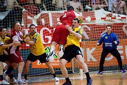 David Kovac (4) of Slovan and Marko Ostir  of Gorenje at handball match of MIK 1st Men league between RD Slovan and RK Gorenje Velenje, on May 16, 2009, in Arena Kodeljevo, Ljubljana, Slovenia. Gorenje won 27:26. (Photo by Vid Ponikvar / Sportida)