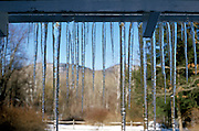Icicles hanging in front of a mountain view