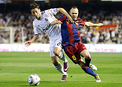 20-04-2011 VOETBAL: COPA DEL REY FC BARCELONA - REAL MADRID: VALENCIA<br /> Andres Iniesta (r) and Real Madrids Mesut Ozil (l)<br /> **NETHERLANDS ONLY**<br /> ©2011-FRH/EXPA/ Alterphotos/ Acero