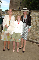 Left to right, LADY EDWINA GROSVENOR, LADY VIOLA GROSVENOR and their mother the DUCHESS OF WESTMNSTER at the wedding of Hugh van Cutsem to Rose Astor in Burford, Oxfordshire on 4th June 2005.<br />