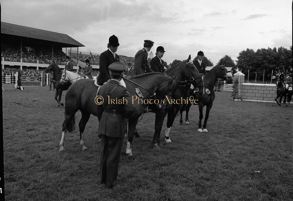 Aga Khan Trophy..1979..10.08.1979..08.10.1979..10th August 1979..The annual staging of the Aga Khan Cup took place  at the Royal Dublin Showgrounds, Ballsbridge,Dublin today.It was the first time since 1937 that Ireland won the trophy outright. The winning Irish team comprised of Paul Darragh,Capt Con Power,James Kernan and Eddie Macken..Image shows Col Ringrose,Chef de Quipe of the Irish team and the winning Irish team lining up for the presentation of the Aga Khan Cup.