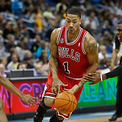 February 12, 2011; New Orleans, LA, USA; Chicago Bulls point guard Derrick Rose (1) has the ball knocked away by New Orleans Hornets point guard Chris Paul (3) during the third quarter at the New Orleans Arena.  The Bulls defeated the Hornets 97-88. Mandatory Credit: Derick E. Hingle