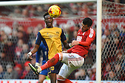 Bristol City forward Tammy Abraham (9) (on loan from Chelsea) in the Forest area with Nottingham Forest Daniel Pinilos (3) during the EFL Sky Bet Championship match between Nottingham Forest and Bristol City at the City Ground, Nottingham, England on 21 January 2017. Photo by Jon Hobley.