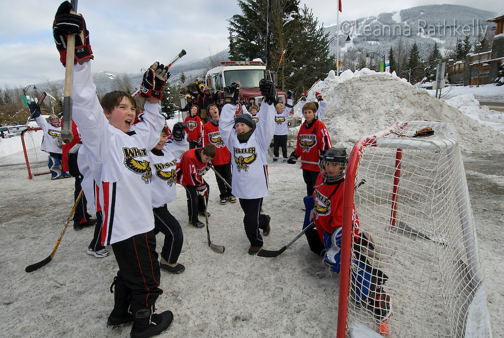 CAR! A street hockey game has to move for the Firetruck to pass in Whistler, BC Canada