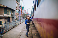 Staff along a train platform, Long Bien, Hanoi, Vietnam, Southeast Asia