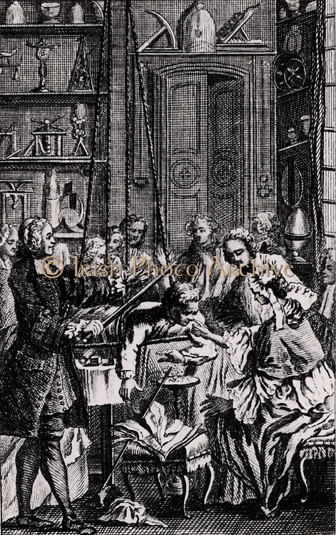 Jean-Antoine Nollet (1700-1770) French physicist and churchman, known as Abbe Nollet, demonstrating the effects of static electricity to fashionable ladies and gentlemen. The lady is drawing sparks from the nose of the Abbe's 'charged' assistant who is lying a platform suspended by silken cords.  From 'Essai sur l'Electricite des Corps' by Abbe Nollet (Paris, 1765). Engraving.