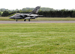 © under license to London News Pictures. 08/04/11 Prime Minister David Cameron is to look again at cuts to the defence budget. According to the reports, plans to scrap RAF Tornados and surveillance planes may be reversed. FILE PICTURE DATED 03/06/09. -an RAF Tornado fighter bomber taxis to a parking area after landing at RAF Marham in Norfolk. Credit should read Matt Cetti-Roberts/LNP