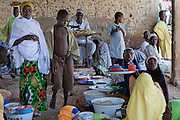 People are visiting the market in Bagega, pop. 9000, a large village affected by lead poisoning due to the unsafe techniques employed for extracting gold, in Zamfara State, Nigeria. It is mainly caused by ingestion and breathing of lead particles released in the steps to isolate the gold from other metals. This type of lead is soluble in stomach acid and children under-5 are most affected, as they tend to ingest more through their hands by touching the ground, and are developing symptoms often leading to death or serious disabilities.