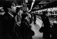 Stoic evening commuters wait in an orderly fashion for the train home.    Despite the famously stoic character of the Japanese people, cracks have begun to form in the facade in the most severe financial crisis since the Great Depression.