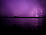 "Rain falling on the James River with lightning storm over historic Jamestown Island. Site of the first permanent English settlement in the New World, established in 1607, Virginia. This view is from the Colonial Parkway in the Colonial National Historical Park (U.S. National Park Service,) in Virginia's ""Historic Triangle"" (Jamestown-Williamsburg-Yorktown.)"