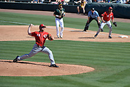 MESA, AZ - MARCH 09:  Barrett Astin #48 of the Cincinnati Reds delivers a pitch in the third inning of the spring training game against the Oakland Athleticsnat HoHoKam Stadium on March 9, 2017 in Mesa, Arizona.  (Photo by Jennifer Stewart/Getty Images)