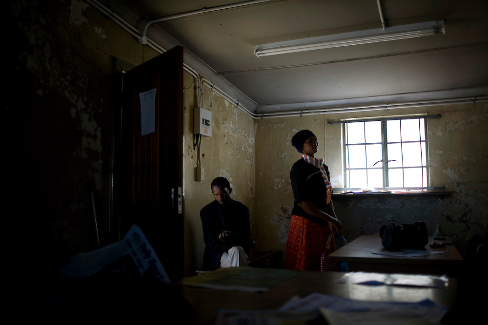 People stand in a city office in Eastern Cape, where many gold miners come from.  South African Gold miners are particularly vulnerable to contracting TB because of the small, poorly ventilated work conditions, high rates of TB and high rates of silicosis, a lung disease often found in miners that increases the chance of catching TB.