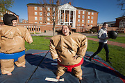 Taylor Ball laughs after slipping into the sumo wrestling outfit to battle her friend Taryn Meidl during the Extreme on the Green event April 16, 2014.  Leading up to finals, a variety of activities are planed to celebrate spring and the end of the school year at Ohio University.  Photo by Ohio University / Jonathan Adams