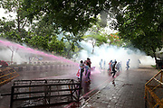 "May 26, 2017 - Dhaka, Bangladesh – Bangladesh police fire a water cannon as left wing students march in the street towards the Supreme Court to protest in Dhaka on May 26, 2017 after the removal of a controversial statue that Islamist radicals had protested against for months, calling it an ""un-Islamic"" Greek deity. Bangladesh on May 26 removed a controversial statue depicting a goddess of justice outside its Supreme Court that religious hardliners had deemed ""un-Islamic"", a move its creator said marked a victory for Islamists. © Monirul Alam"