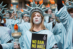 April 27, 2017 - London - One hundred Amnesty International activists dressed as 'Statues of Liberty' protest outside the US Embassy in London  to mark US President Trump's first 100 days in office. (Credit Image: © Tolga Akmen/London News Pictures via ZUMA Wire)
