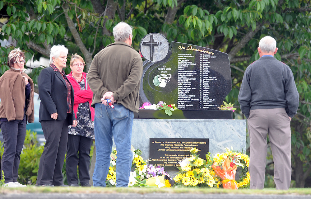 Visitors pay their respects at the memorial for the 29 victims of the Pike River Coal Mine tragedy, Greymouth, New Zeland, Saturday, November 19, 2011. Credit:SNPA / Ross Setford