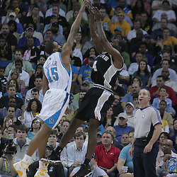 17 December 2008:  San Antonio Spurs guard Michael Finley (4) shoots over New Orleans Hornets guard Rasual Butler (45) during a NBA regular season game between the Western Conference rivals the San Antonio Spurs and the New Orleans Hornets at the New Orleans Arena in New Orleans, LA..