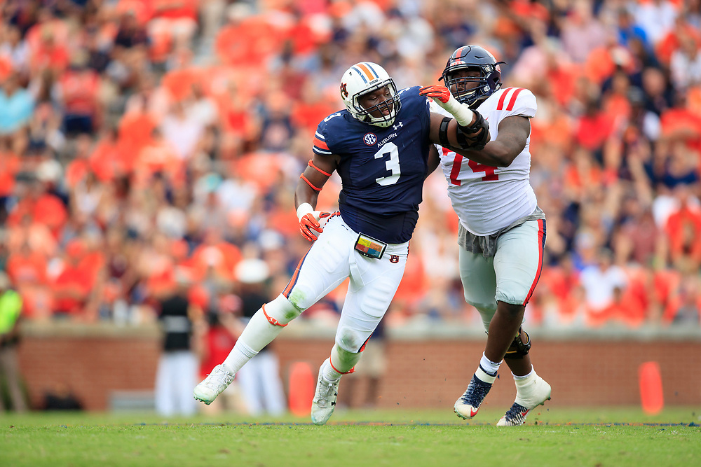 Auburn Tigers defensive lineman Marlon Davidson (3) works against Mississippi Rebels offensive lineman Greg Little (74) during an NCAA football game, Saturday, October 7, 2017, in Auburn, AL. Auburn won 44-23. (Paul Abell via Abell Images for Chick-fil-A Peach Bowl)