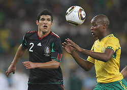 11.06.2010, Soccer City Stadium, Johannesburg, RSA, FIFA WM 2010, Südafrika (RSA) vs Mexico (MEX), im Bild Katlego Mphela of South Africa in action with Francisco J. Rodriguez of Mexico, EXPA Pictures © 2010, PhotoCredit: EXPA/ IPS/ Mark Atkins