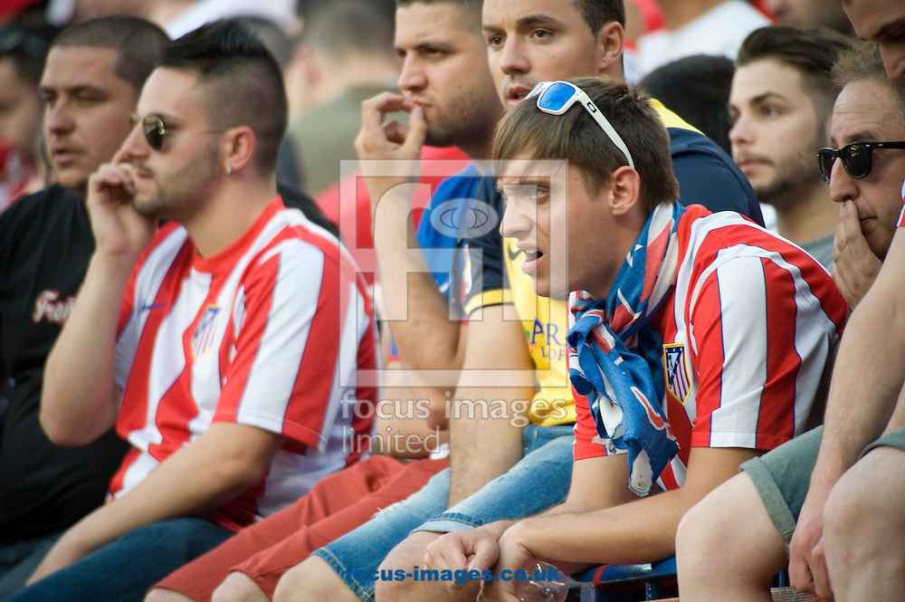 Supporters of Atl&eacute;tico Madrid dejected by the goal of Malaga during the La Liga match at Vicente Calder&oacute;n Stadium, Madrid<br /> Picture by Marcos Calvo Mesa/Focus Images Ltd +34 654142934<br /> 11/05/2014