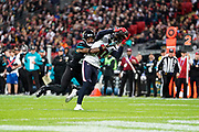 Houston Texans Wide Receiver DeAndre Hopkins (10)  catches the ball under pressure in the red zone during the International Series match between Jacksonville Jaguars and Houston Texans at Wembley Stadium, London, England on 3 November 2019.