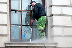 (c) London News Pictures. 10.12.2010. A worker cleans graffiti . The clean-up operation in Westminster following last night's student demonstration. Picture credit should read: Brian Duckett/London News Pictures