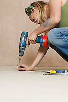 Woman drilling floor close-up