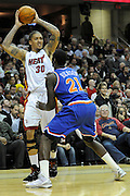 Feb 4, 2010; Cleveland, OH, USA; Miami Heat forward Michael Beasley (30) looks for a pass over Cleveland Cavaliers forward J.J. Hickson (21) during the second quarter at Quicken Loans Arena. Mandatory Credit: Jason Miller-US PRESSWIRE