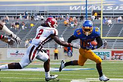 September 24, 2011; San Jose, CA, USA;  San Jose State Spartans wide receiver Chandler Jones (89) rushes past New Mexico State Aggies defensive back Ben Bradley (2) during the third quarter at Spartan Stadium. San Jose State defeated New Mexico State 34-24.