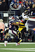New England Patriots cornerback Eric Rowe (25) breaks up a deep pass intended for leaping Pittsburgh Steelers wide receiver Sammie Coates (14) in the second quarter during the AFC Championship NFL football game against the New England Patriots on Sunday, Jan. 22, 2017 in Foxborough, Mass. The Patriots won the game 36-17. (©Paul Anthony Spinelli)