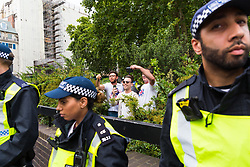 """Organiser Danny Tommo, in sunglasses is seen in Cavendish Square taunting anti-fascist counter protesters as several hundred protesters gather in central London demanding the release of """"political prisoner"""" right wing talisman Stephen Yaxley-Lennon  - also known as Tommy Robinson, who was imprisoned for contempt of court. London, August 03 2019."""