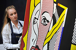 "© Licensed to London News Pictures. 06/10/2017. London, UK. A technician presents a ""Female Head"", 1977, by Roy Lichtenstein at a preview at Sotheby's in New Bond Street of contemporary, impressionist and modern art works to be auctioned in New York in November 2017 Photo credit : Stephen Chung/LNP"