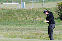 Rory McIlroy, professional golfer, N Ireland, UK, chipping unto the green. 200905122249..Taken at the Irish Open practice day, Tuesday, 12th May, 2009, at Baltray.<br />
