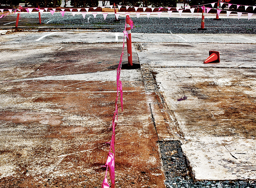 Outdoor urban parking area with pink flags