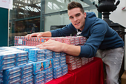 © London News Pictures. 26/10/2013 . London, UK. Gaz from Geordie Shore poses with boxes of condoms at the Erotica show at Tobacco Dock in East London on 25 October 2013. The three day event runs from 25 October until 27 October and features stalls selling sex toys and clothes and stage shows of exotic dancing. Photo credit : Vickie Flores/LNP
