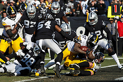 OAKLAND, CA - DECEMBER 09: Running back Stevan Ridley #22 of the Pittsburgh Steelers scores a touchdown  against the Oakland Raiders during the second quarter at O.co Coliseum on December 9, 2018 in Oakland, California. (Photo by Jason O. Watson/Getty Images) *** Local Caption *** Stevan Ridley