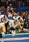 New England Patriots wide receiver David Patten (86) leaps and reaches high in the air while catching an end zone pass for an 8 yard touchdown reception during the 2002 NFL Super Bowl XXXVI playoff football game against the St. Louis Rams on Sunday, Feb. 3, 2002 in New Orleans. The Patriots won the game 20-17. (©Paul Anthony Spinelli)