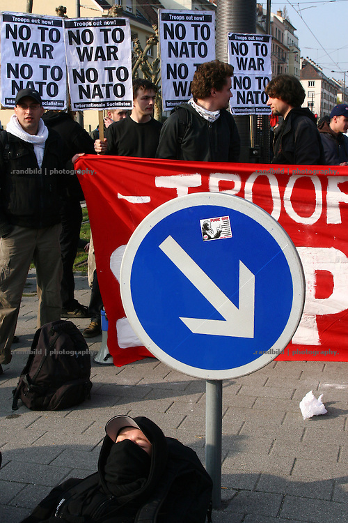 About 15.000 people demonstrated in strasbourg against the Nato Summit. In the early morning (04.April) several hundred activists of a non-violent movement blocked some roads to the red zone, which ws etablished in town to protect the conference centre. During the whole day police and protesters clashes in the outskirts. Barrikades were erected. A Ibis Hotel, a former border guard office and a drugstore were burnt by protesters. A gas station was looted. Several people got injured by stones, stun granates and tear gas.