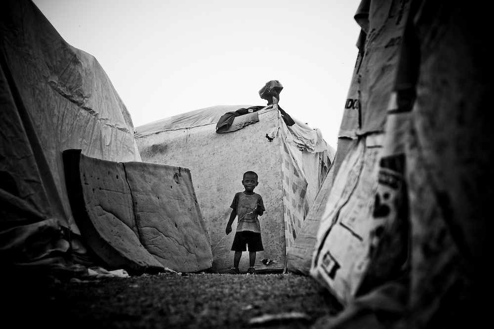 A boy stands in a path in a camp for those displaced by the recent earthquake in Petionville, outside Port-au-Prince, Haiti.