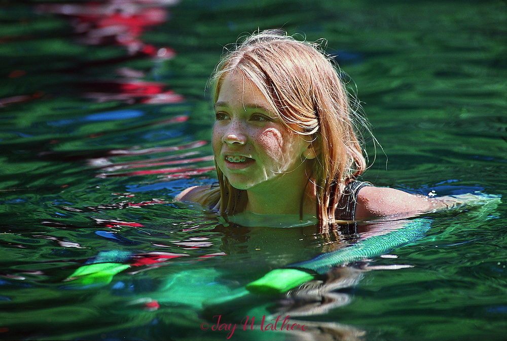 Tia Shelley (cq), 12, from Tracy, CA, enjoys an afternoon swimming session during her week-long stay at Camp Menzies Girl Scout camp. June, 27, 2000.