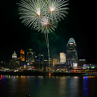Fireworks over Cincinnati Skyline with reflections in Ohio River.