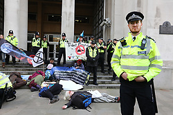 © Licensed to London News Pictures. 09/10/2019. London, UK. XR activist takeover the front of the MOD in Westminster. Activists continue to occupy roads around Westminster for the 3nd day. Photo credit: Alex Lentati/LNP